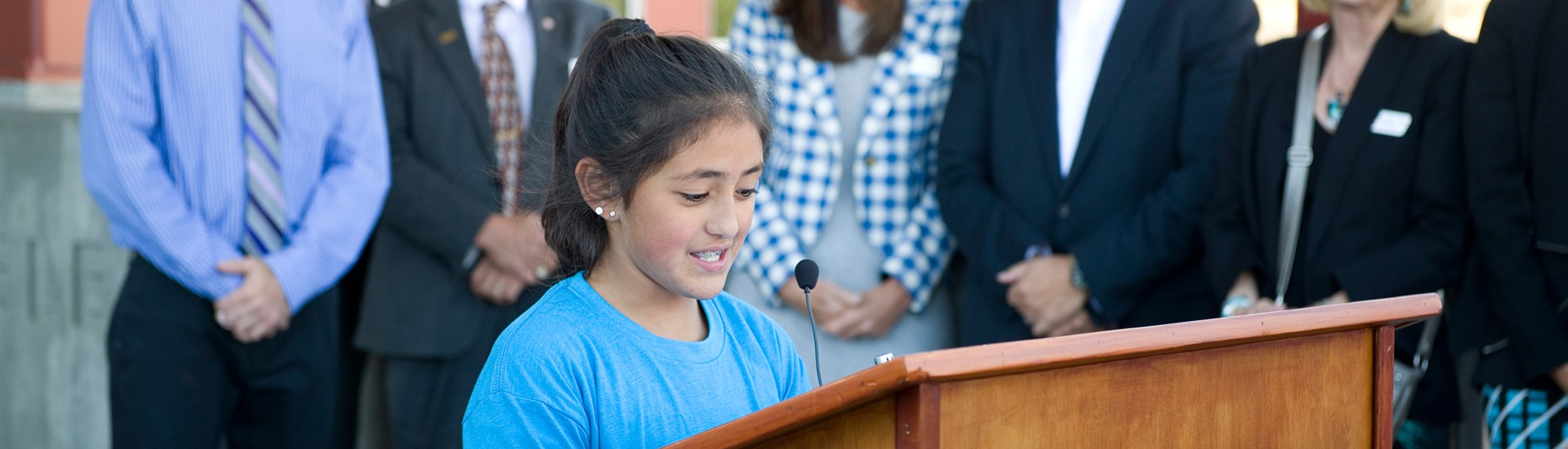 Student makes remarks during Munger Mountain elementary ribbon cutting event