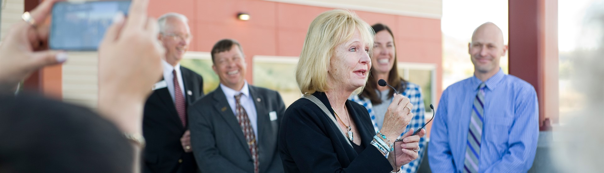 Trustee Janine Bay Teske makes remarks at Munger Mountain ribbon cutting event
