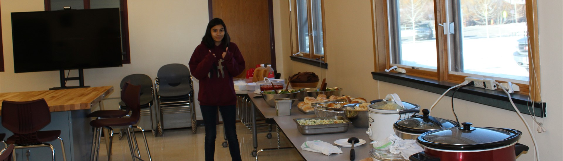 Summit student puts finishing touches on lunch buffet