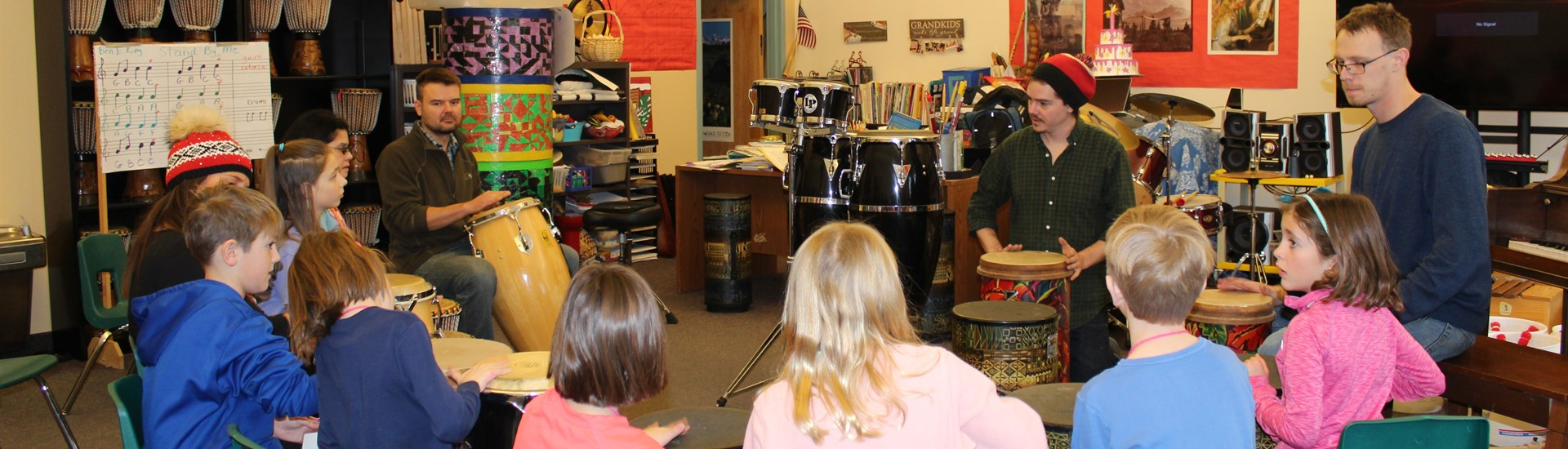 Students learn drums from visiting musicians