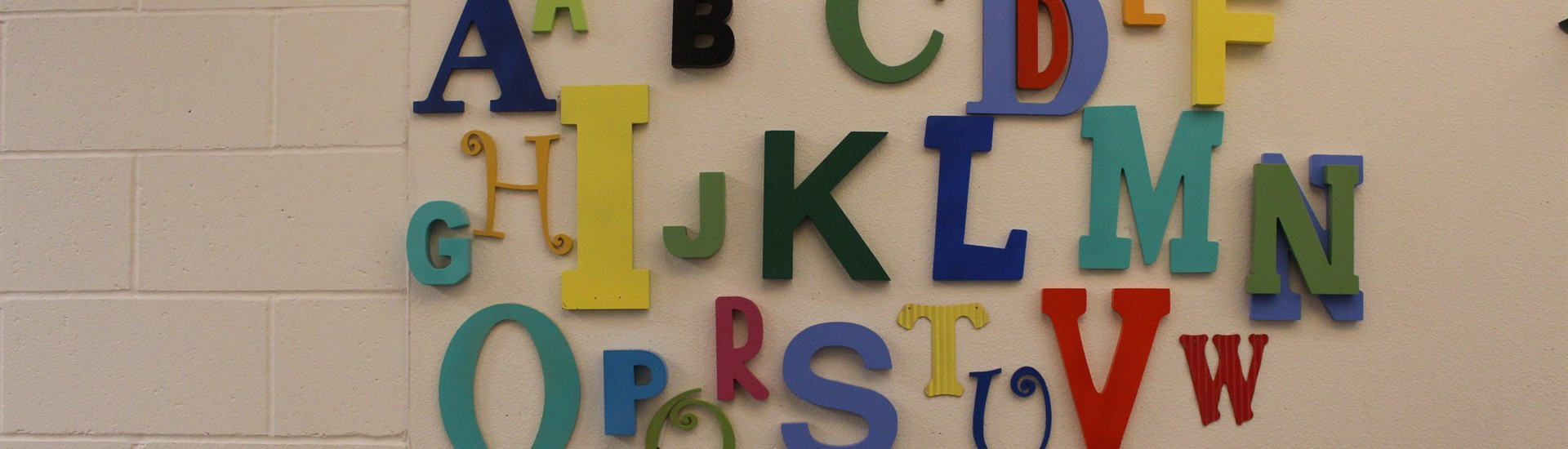 Teaching the ABCs in the kinder hallway